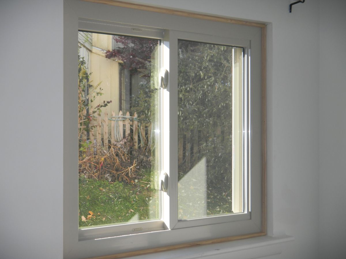 almond color vinyl sliding window