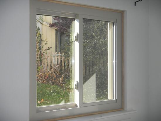 almond color vinyl sliding window