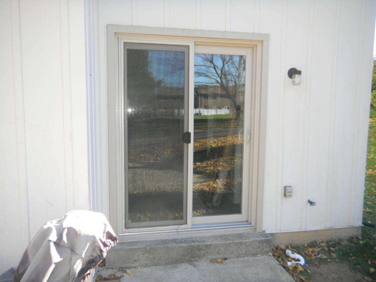 almond / beige patio door