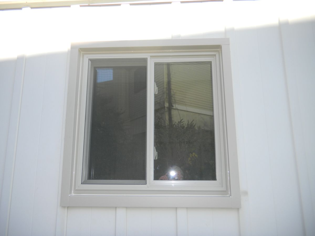 almond color window viewed from exterior of home
