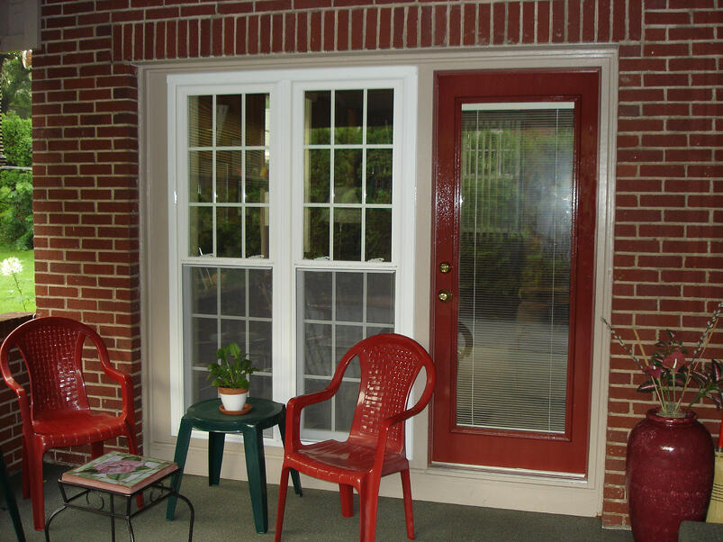 Exterior of steel door with blinds between glass....the blinds are raised
