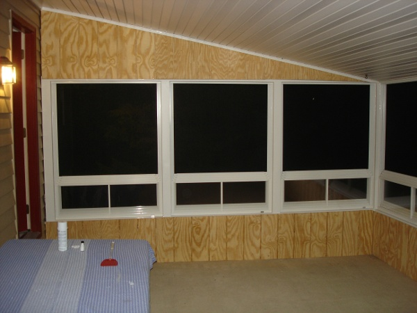 end wall with panels open at night