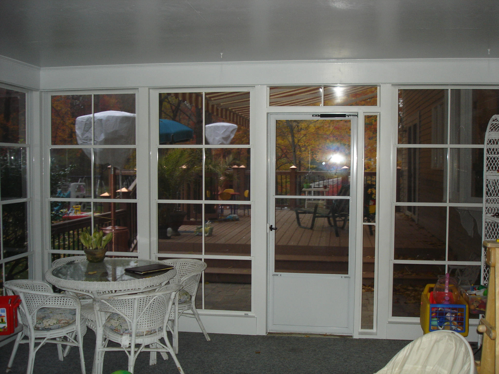 interior view of new enclosure with storm door out to awning area