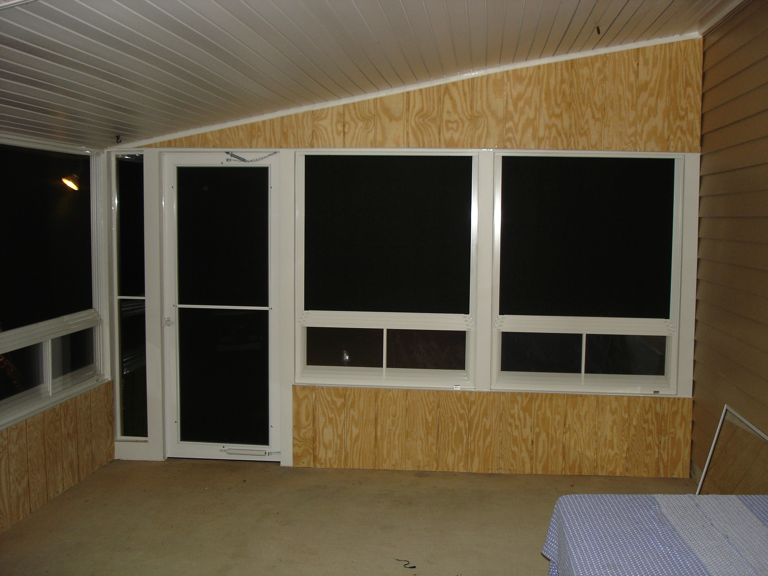 completed interior at night with storm door