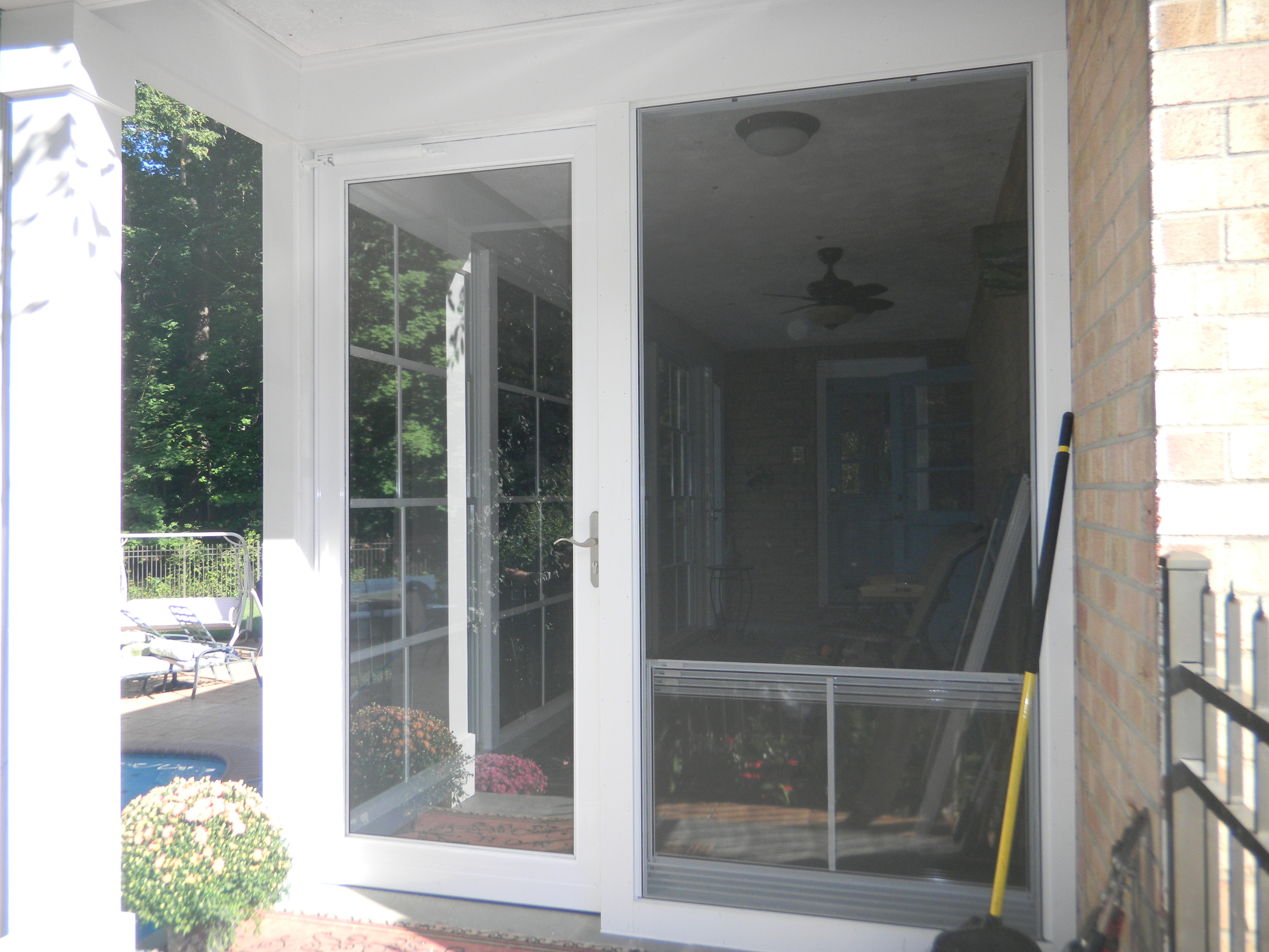 end wall with new storm door and vertical four track