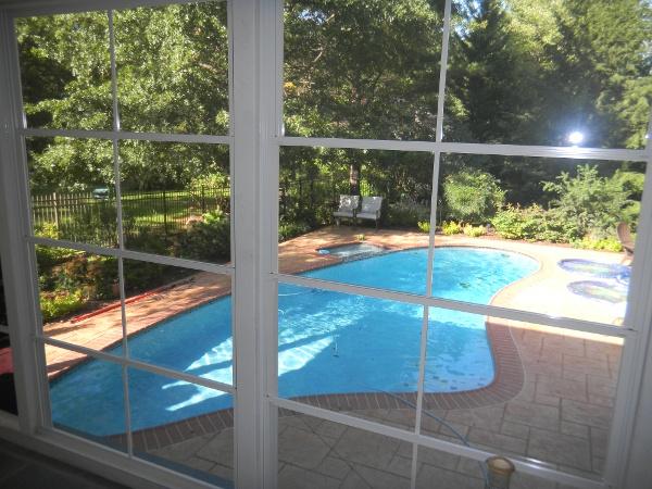 clear vinyl units overlooking pool