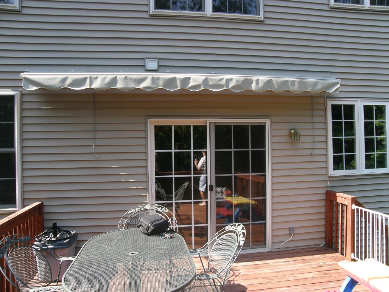 vinyl fabric on a motorized retractable awning