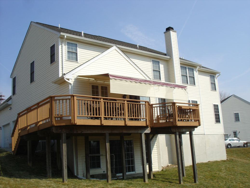 motorized retractable awning with drop valence makes deck usable in full sun