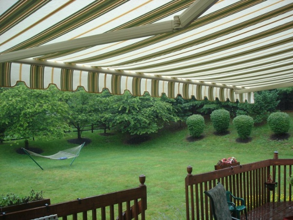 backyard room created with motorized retractable awning