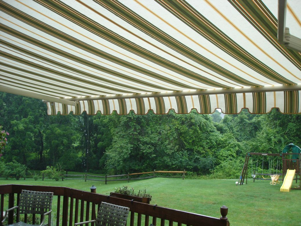 create an outdoor living room with a motorized retractable awning