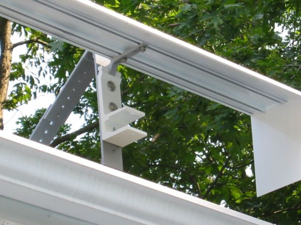 roof mount awning bracket with awning hood attached
