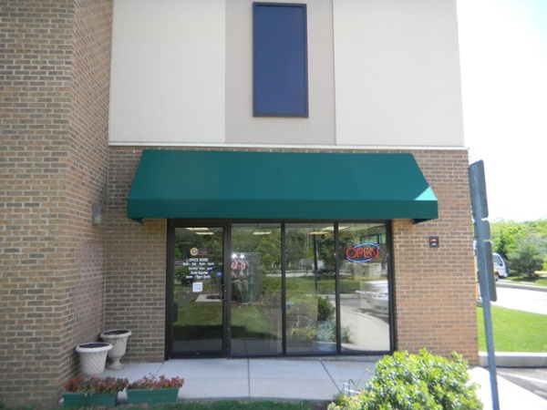 canopy protects entrance of commercial building
