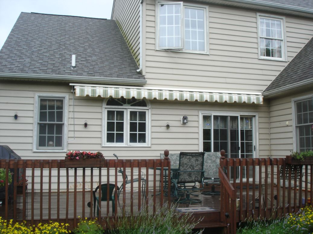motorized retractable awning mounted over half round window
